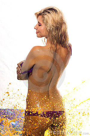 wet girl in fountain of yellow water