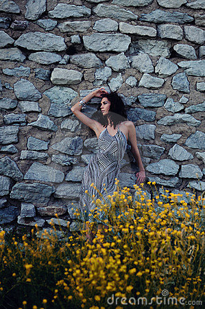 Sexy Woman Against Old Stone Wall