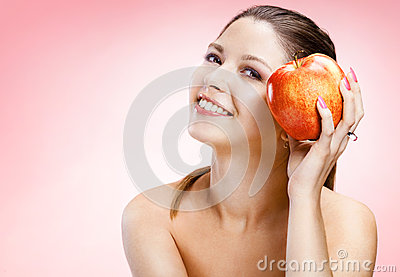 Sexy woman with apple