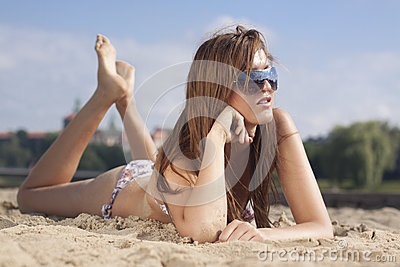 Sexy woman on beach in sunglasses