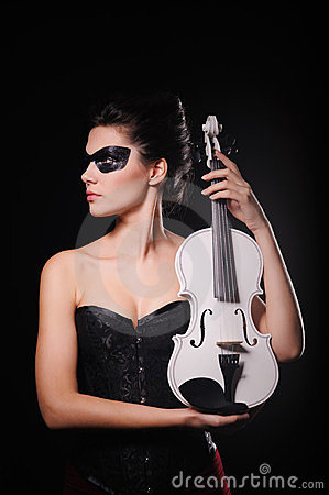 Sexy woman with black party mask and white violin