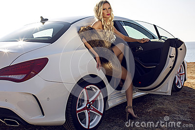 Sexy Woman With Blond Hair Posing In Luxurious White Car