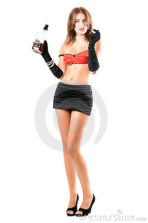 Sexy woman posing with a bottle of alcohol drink. Isolated.