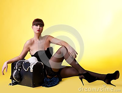 Sexy woman with broken baggage