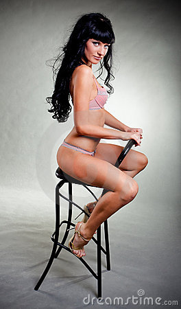 Sexy woman on chair