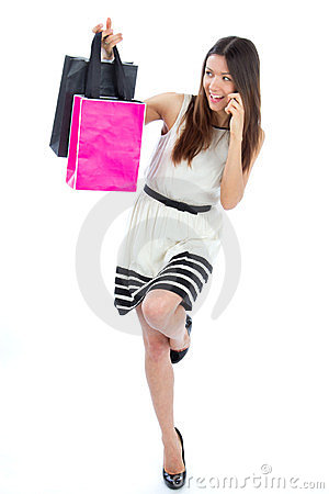 Sexy woman with colorful gift shopping bags