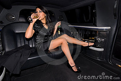 Sexy woman drinking Champagne.