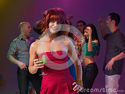 Sexy woman drinking cocktail in night club