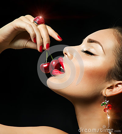 Free Sexy Woman Eating Cherry Royalty Free Stock Photo - 31454015