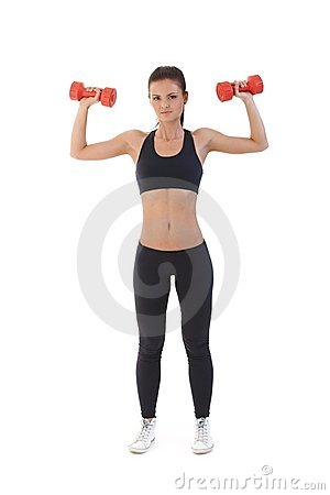 Sexy woman exercising with dumbbells