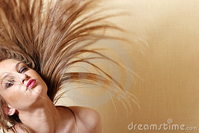 Sexy woman flipping hair