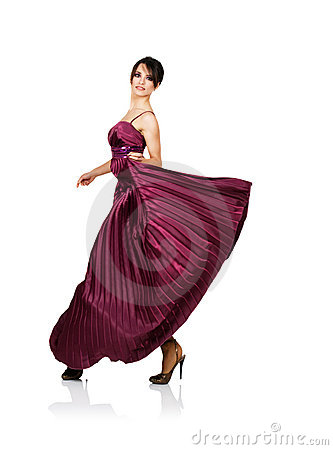 Sexy woman with flying elegant dress