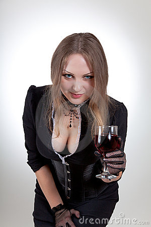 Sexy woman with glass of wine