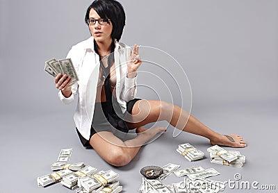 Sexy woman handling lots of cash