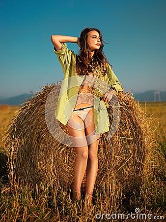 Sexy woman by haystack