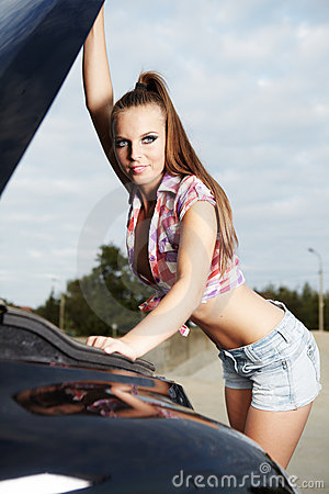 Sexy woman with her broken car.