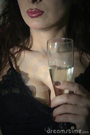 Sexy woman holding glass of wine