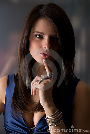 Sexy woman holding her finger to her lips