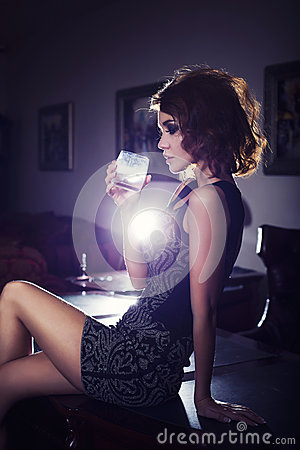 Free Sexy Woman In Back Light Standing Near Table With Beverage Indoor Royalty Free Stock Photos - 47942938