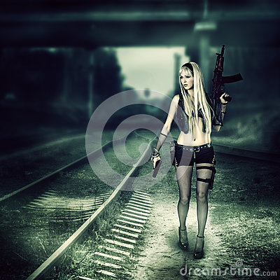 Free Sexy Woman Killer Holding Automatic And Gun Stock Image - 39397891