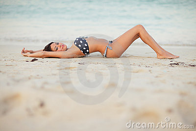 Sexy woman laying on the sand
