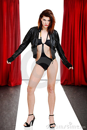 Sexy woman with leather jacket on catwalk