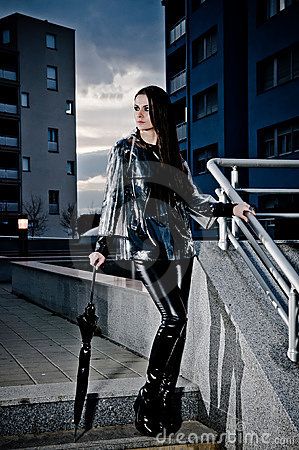 Sexy Woman In Leather And Raincoat