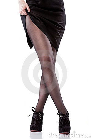 Sexy woman legs and shoes isolated on white