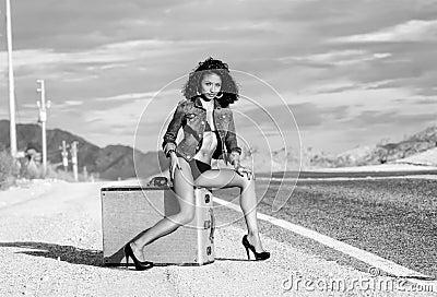 Sexy woman long legs suitcase open road