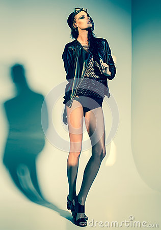 Free Sexy Woman Model Dressed Punk, Wet Look, Posing In The Studio Stock Photography - 55695782