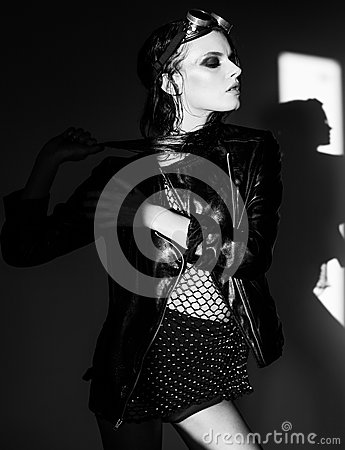 Free Sexy Woman Model Dressed Punk, Wet Look, Posing In The Studio Royalty Free Stock Photos - 55727348
