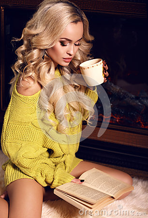 Free Sexy Woman Reading Book And Drinking Tea Beside A Chimney Stock Photo - 47280430