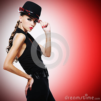 Sexy woman with red lips and nails in modern black hat