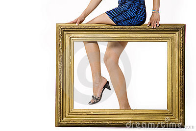 Sexy woman s legs behind a frame