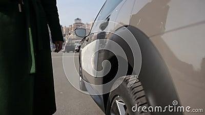 woman`s legs in high heels walking in street stock video footage