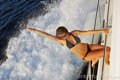 Sexy woman sailing speed-boat yacht