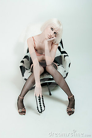 Sexy woman sat in chair