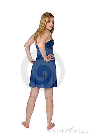 Sexy woman in short blue dress and bare feet