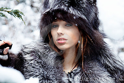 Sexy woman in snowy winter outdoors