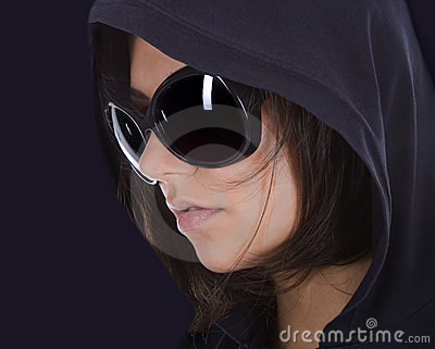 Sexy woman in sunglasses with hood.
