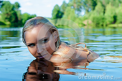 Sexy woman swimming in the water