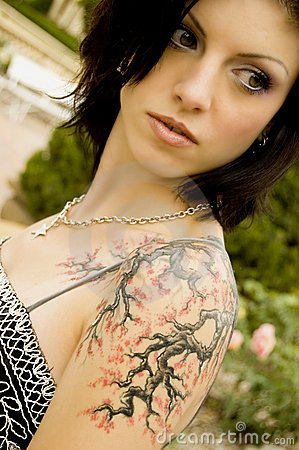 Sexy woman with tattoo in dress