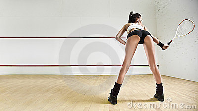Sexy woman with tennis racket in squash