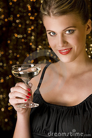 Sexy woman toasting with glass of champagne