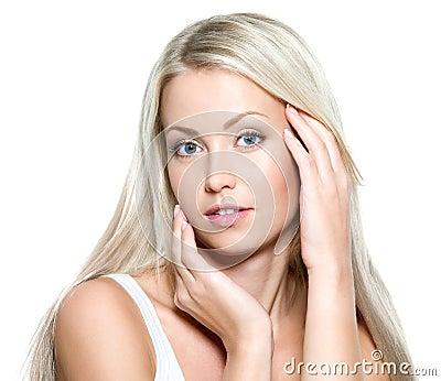 Sexy woman touching her fresh face