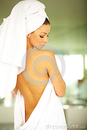 Sexy woman with towel wrapped after taking bath