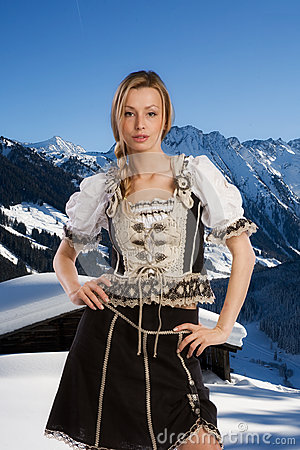 Sexy woman in traditional clothes in the mountains