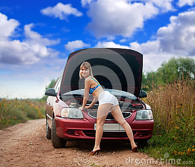 Sexy woman trying to fix  car