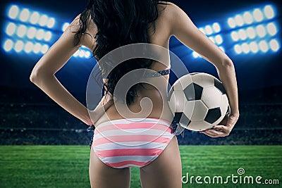 Sexy woman wearing bikini at field