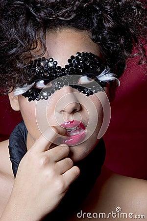 Sexy woman wearing a gem mask